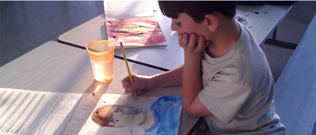 child painting watercolors